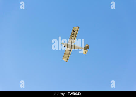 Single engined, two seater, light aircraft type Comco Ikarus C42 Cyclone FB80 flying low directly overhead in the - Stock Image