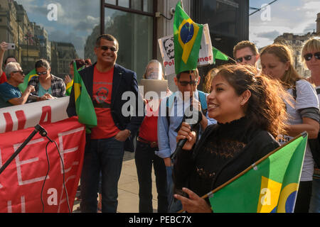 London, UK. 13th August 2018.  Newham Cllr Belgica Guania, the first Ecuadorian councillor in the UK speaks in support of the Brazilian protest outside the Brazilian embassy calling for the release of Luiz Inacio Lula da Silva, a former trade union leader who was President of Brazil from 2003-11 to enable him to stand for election again in October. Credit: Peter Marshall/Alamy Live News - Stock Image