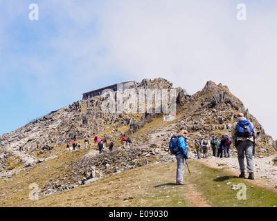 Walkers walking on Rhyd Ddu path to Mt Snowdon summit café on busy weekend in Snowdonia National Park. Gwynedd North Wales UK - Stock Image