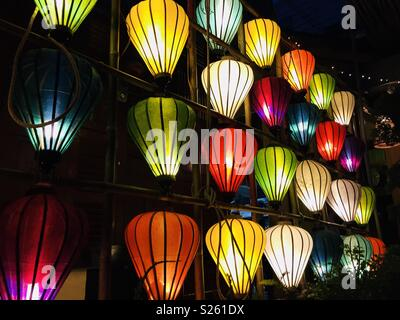 different coloured lanterns used as decoration - Stock Image