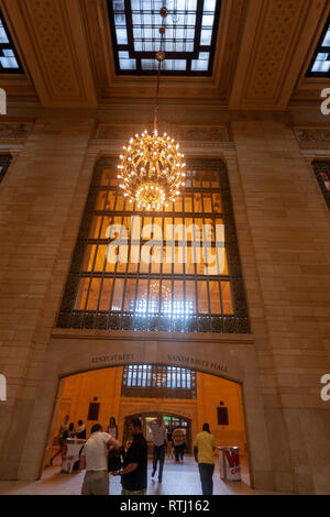 Two of the concourse's ten chandeliers, Grand Central Terminal, Manhattan, New York, USA - Stock Image