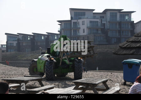 Perranporth, Cornwall,UK. 31st March 2019. UK Weather. It was hot and sunny for the first day of British Summertime on the beach at Perranporth. The watering hole pub was busy bringing out extra tables ahead of the mothers day rush for meals outside. Credit: Simon Maycock/Alamy Live News - Stock Image