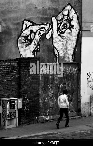 Italy. Milan Street art. Big hands on wall - Stock Image