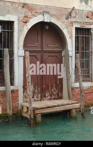 A weathered door in Venice Italy - Stock Image