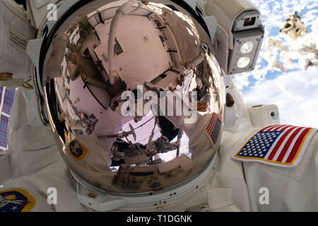 Expedition 59 NASA astronaut Nick Hague takes a selfie while working on the power supply during a spacewalk outside the International Space Station March 22, 2019 in Earth Orbit. Astronauts McClain and Hague spent six-hours and 39-minutes outside the space station to upgrade the orbital complex's power storage capacity. - Stock Image