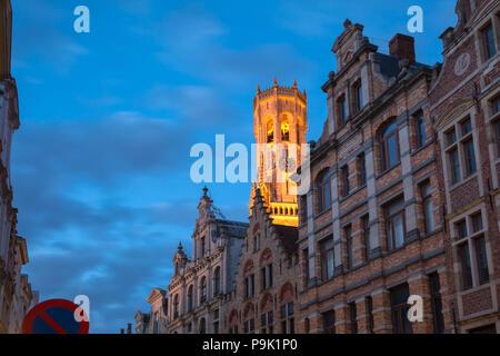 Night street and tower Belfort in Bruges, Belgium - Stock Image