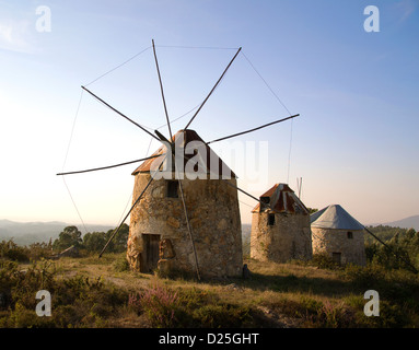 A group of three windmills, in center Portugal, near Coimbra. - Stock Image
