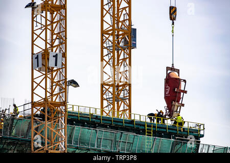 Construction cranes, construction site in Amsterdam, NDSM Werf, new construction of a building - Stock Image