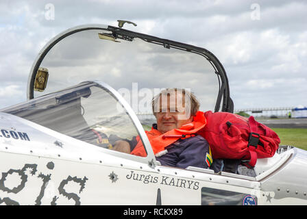 Jurgis Kairys, Lithuanian aerobatic pilot and aeronautical engineer. Has won many awards in world aerobatics. In plane cockpit with fake bullet holes - Stock Image