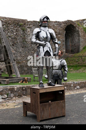 A Knight in full Armour preparing  to mount his steed,   for an English Heritage Jousting Tournament at Dover Castle, August 2018 - Stock Image