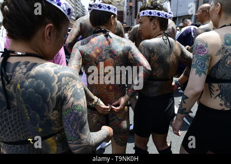 TOKYO, JAPAN - MAY 18: Heavily tattooed Japanese women chat in the street as they wait for the portable shrine in the street of Asakusa during 'Sanja Matsuri' on May 18, 2019 in Tokyo, Japan. A boisterous traditional mikoshi (portable shrine) is carried in the streets of Asakusa to bring goodluck, blessings and prosperity to the area and its inhabitants. (Photo: Richard Atrero de Guzman/ AFLO) - Stock Image