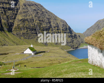 White church at Saksun on the sea near the north end of the main island of the Faroes Archipelago - Stock Image