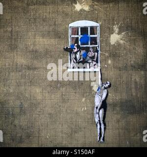 Banksy artwork in Bristol of the well hung lover - Stock Image
