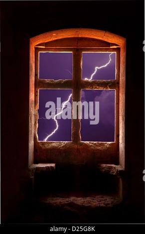 An impressive lightning bolt seen thru a window. - Stock Image