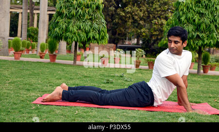 Man practicing yoga  at Outdoor - Stock Image