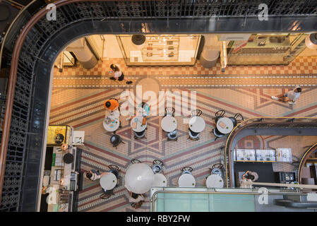 Looking down on patrons at a coffee shop inside the Queen Victoria Building, known locally as simply the QVB, in Sydney Australia - Stock Image