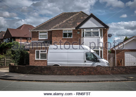 White van in front of house in suburb of West Midlands - Stock Image