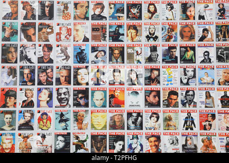 Exhibition of historic Face magazine covers on side of Lewis Cubitt Square at Kings Cross, north London, UK - Stock Image