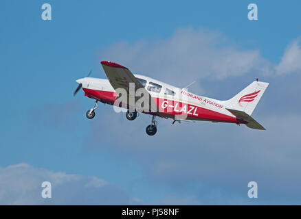Flying out from Highland aviation building at Inverness Dalcross airport on a training lesson with a student pilot. - Stock Image