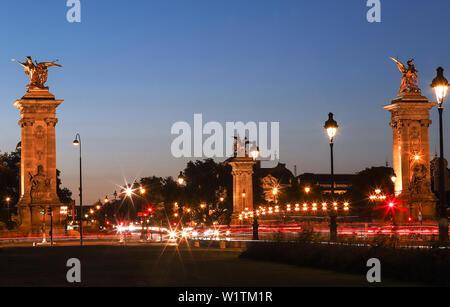 The famous Alexandre III bridge in Paris, France - Stock Image