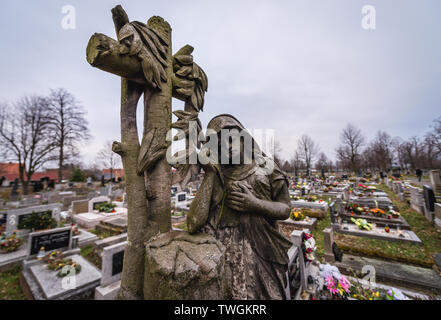 Cemetery in front of Church of the Virgin Mary in Broumov town in Nachod District of Czech Republic, oldest preserved all-wood construction in Central - Stock Image