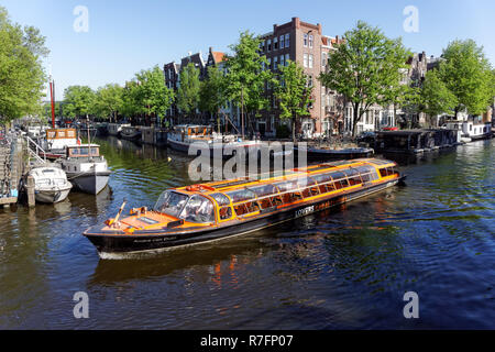 Tourist cruise boat in Amsterdam, Netherlands - Stock Image