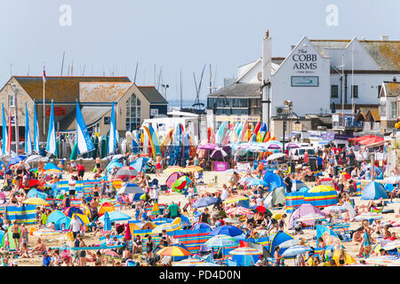 Lyme Regis beach on a hot sunny day in summer, Dorset, UK. - Stock Image