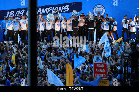 Manchester City players and staff on stage during the trophy parade in Manchester. - Stock Image