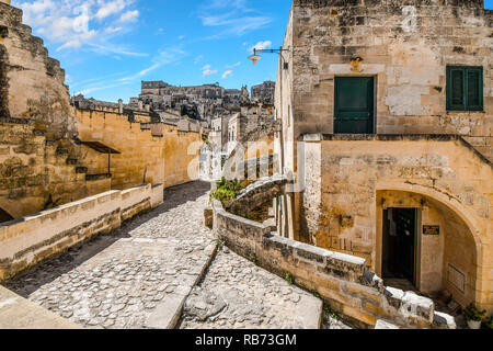 Matera, Italy - September 25 2018: A typical stone back street in the ancient sassi of Matera Italy. - Stock Image