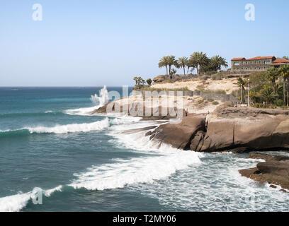 Wave breaking over headland in Costa Adeje, Tenerife, Canary Islands - Stock Image