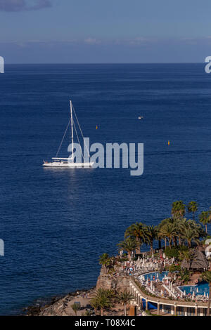 Yacht on the Atlantic Ocean at Taurito, Gran Canaria, Canary Islands - Stock Image