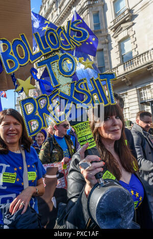 London, UK. 20th October 2018. A wamn holds a saucepan and a 'Bollocks to Brexshit' constructed placard on the People's Vote March calling for a vote to give the final say on the Brexit deal or failure to get a deal as the march leaves Hyde Park Corner. They say the new evidence which has come out since the referendum makes it essential to get a new mandate from the people to leave the EU. Peter Marshall/Alamy Live News - Stock Image