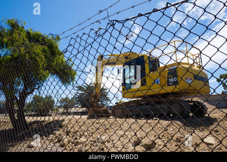 An excavator parked on a section of vacant land in Kingscote on Kangaroo Island in South Australia, Australia. - Stock Image
