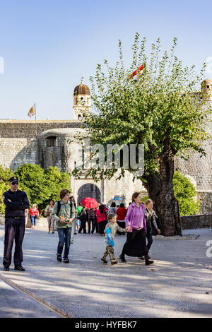 Tourists visiting the wall city in Dubrovnik - Stock Image
