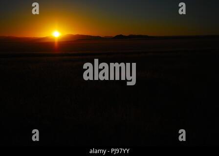 Romantic sunset in Namib desert, Namibia - Stock Image