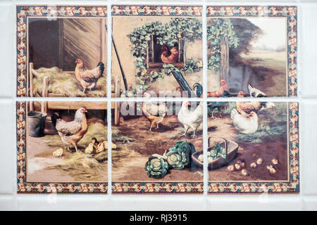 Set of 6 colourful kitchen wall tiles completing a barnyard scene. - Stock Image