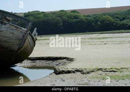 An old boat wreck in the sand in Newquay - Stock Image