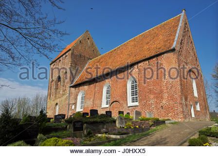 Kirchturm Suurhusen, the leaning church tower located at Hinte in East Friesland, Lower Saxony, Germany. - Stock Image