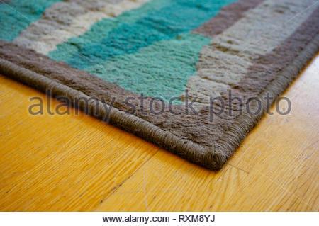 Close up of a floor carpet corner in soft focus. - Stock Image