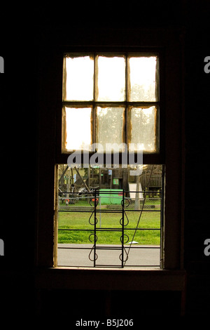 Looking thought a window at playground equipment - Stock Image