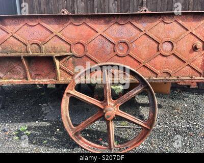 Old red metal cart - Stock Image
