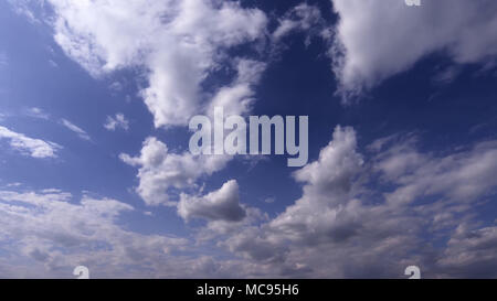 Fantastic soft white clouds against blue sky - Stock Image