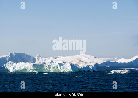 Icebergs stuck at end of Ilulissat Icefjord fed by most productive glacier in northern hemisphere. Disko Bay, Ilulissat, - Stock Image