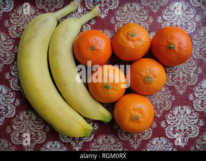 Bananas and tangerines concepts. France - Stock Image