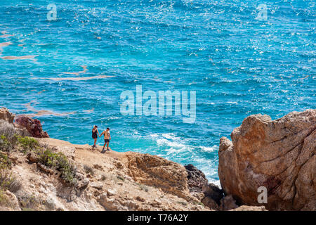 couple hiking at the tidal pools at Grand Fond in St Barts - Stock Image