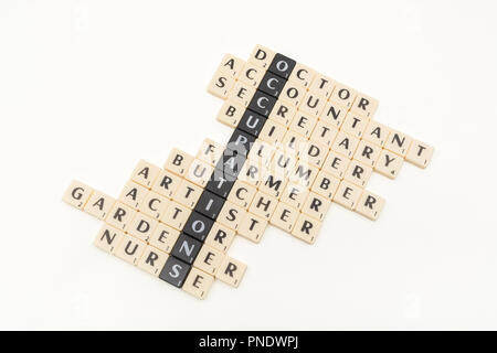 Letter tiles showing the keyword OCCUPATIONS and various types of career choice / types of jobs available. - Stock Image