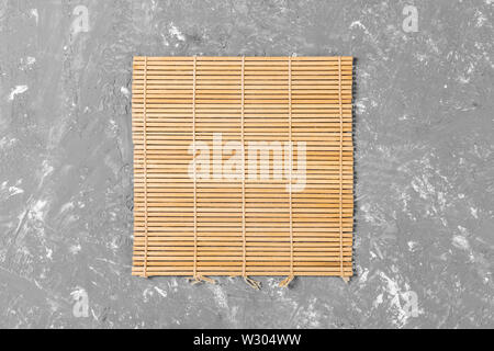 Empty Asian Food Background. brown Bamboo mat on wooden background top view with copy space flat lay. - Stock Image