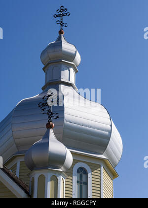 Onion Domes of the Church at the Ukranian Folk Museum: Two domes topped by eastern crosses decorate the roof of the church that is part of this heritage folk museum near Edmonton. - Stock Image