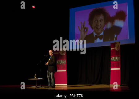 Dean Burnett reads from his book The Happy Brain at the 9th annual Stoke Newington Literary Festival in Hackney, East London 2018 - Stock Image