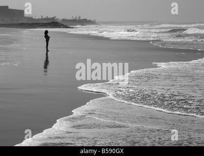 USA A young girl gazes out to sea in Carlsbad California - Stock Image